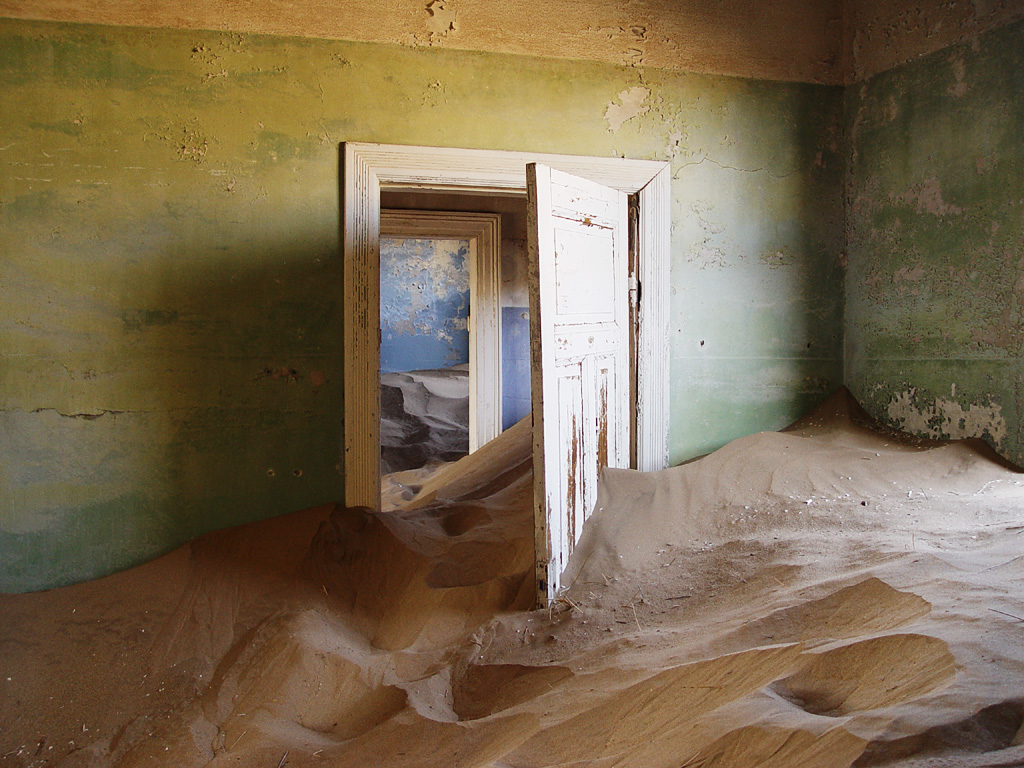 Kolmanskop, Namibia - tourists now walk through houses knee-deep in sand