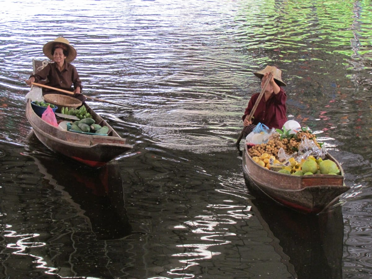 Women in the floating market, Bangkok, Thailand