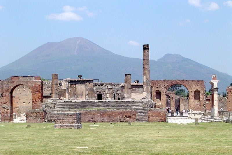 Destinations For History Enthusiasts: Pompeii, Italy (Pompeii with Mount Vesuvius in the background)