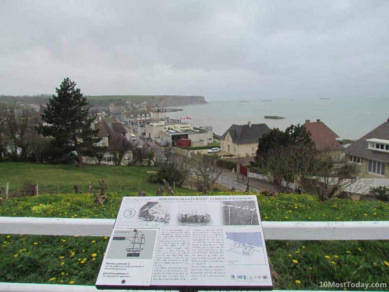 View of Arromanches-les-Bains. In the ocean in front you can see parts of the historic Mulberry harbor
